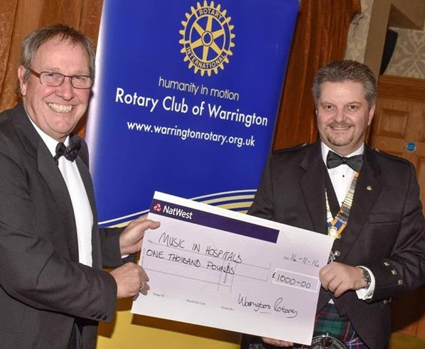 Warrington Rotary Club present Music in Hospitals with a cheque